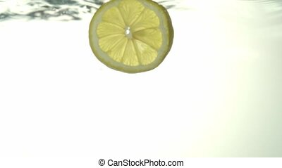 The concept of the freshness of lemon slices in clear water...
