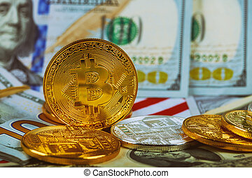 The concept of the value of the crypto currency. golden bitcoin coin on us dollars close up