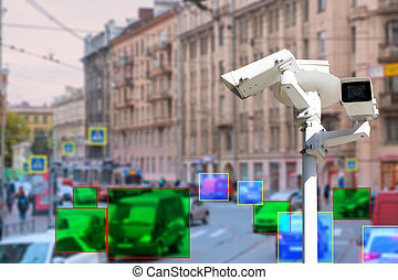The concept of video surveillance and security technologies. Video surveillance camera on the background of the city road with cars. Definition zone at the cars. Tint