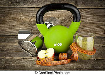 The concept of weight loss, dumbell and kettlebell - The...