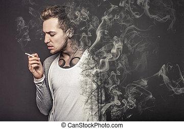 """The concept """"smoking kills"""". Young guy smoking and smolder"""