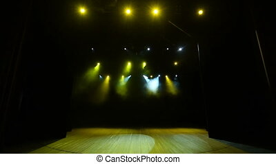 The concert on a stage background with yellow lights