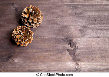 the Cone over a Natural Dark Wooden background. Old dirty wood tables or parquet with knots and holes and aged partculars.