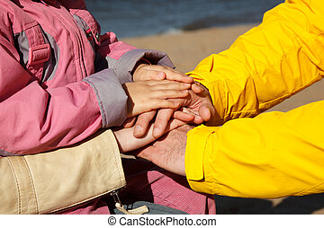 The connected hands of family as support and unity sign....