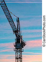 The Construction crane with sunset in the background