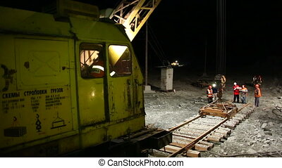 The construction of the railway. Workers laid rails.