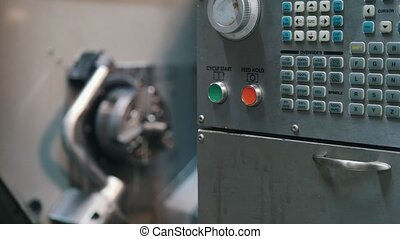 The control panel of the lathe on the factory