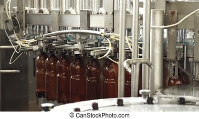 The conveyor belt production of beer in PET plastic bottles.