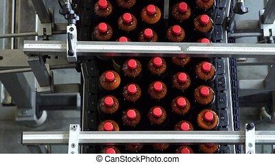 The conveyor belt production of beer in PET plastic bottles.