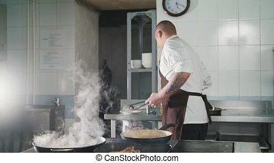 The cook adds spices and onion to food close up