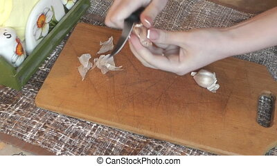 The cook cleans the garlic from the skins - Cook garlic...