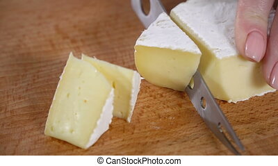 The cook cuts the cheese with white mold - Chef cuts white...