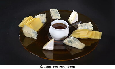 The cook puts the pieces of cheese on a plate