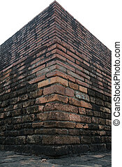 The corner of old brick wall and cloudy sky with selective focus