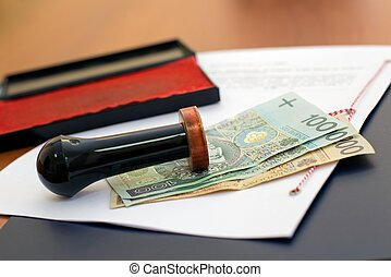 The cost of notary services. Polish money under the stamp...