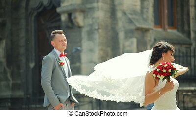 The couple is walking along paving stones in old city FullHD