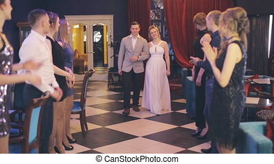 The couple passes through corridor formed by guests - The...