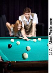 The couple plays billiards