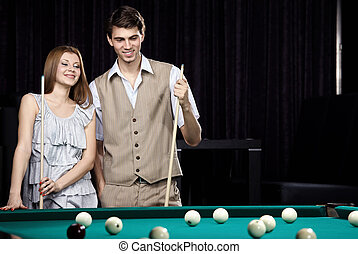 The couple plays billiards