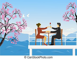 The couple sat on a wooden chair on the rooftop, a man handed red roses to women, cherry blossoms and mountains and the sky as the background