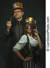 The couple steampunk. A man with a pipe and a girl with ...