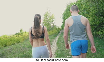The couple strolls by the forest - Young couple walking near...