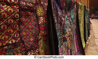 The courtyard with textiles - A straight wide shot of the...