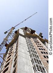 The crane builds a multi-storey building