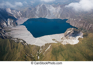 The crater of Mt. Pinatubo from the air, Philippines - The...