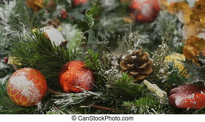 The Cristmas wreath is being sprayed with white color to...