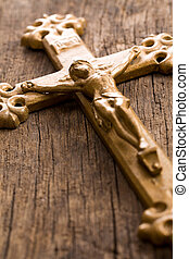 crucifix on wooden background
