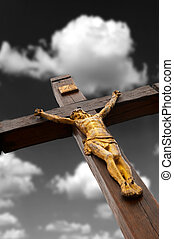 The crucifixion from a tree with Jesus's gilt figure. Drame...