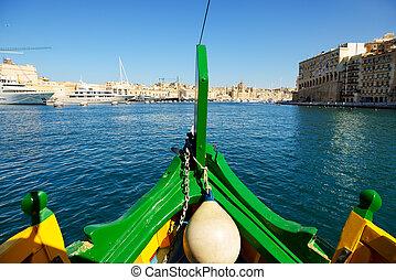 The cruise travel in traditional Maltese Luzzu boat, Malta