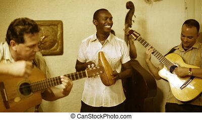 the cuban band eco caribe filmed performing in havana. all...