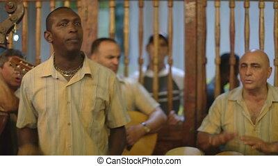 the cuban band eco caribe filmed performing the bodegiuta ...