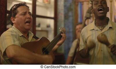 the cuban band eco caribe filmed performing the bodegiuta...