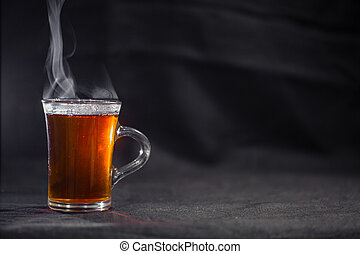 the Cup of tea on a dark background