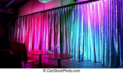 the curtain opens on stage of light-colored lighting. Video...