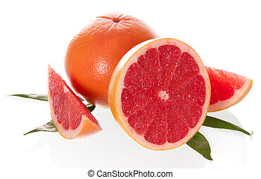 The cut grapefruit with leaves on a white background