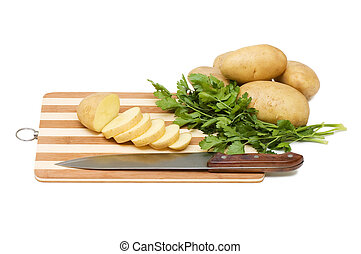 The cut potato on a chopping board