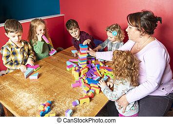 The cute preschoolers group in kindergarten together