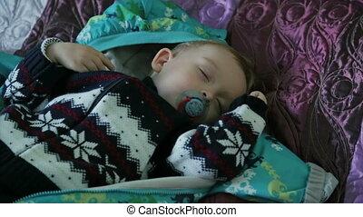 The cute sleeping boy