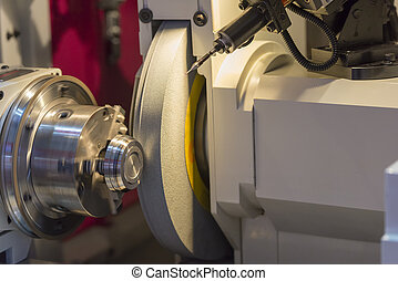 The cylindrical grinding machine with the steel part .Hi...