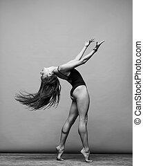 the dancer - Young beautiful dancer is posing in studio