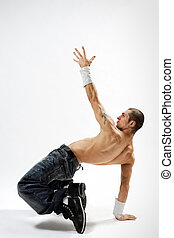 the dancer - modern style dancer posing on studio background