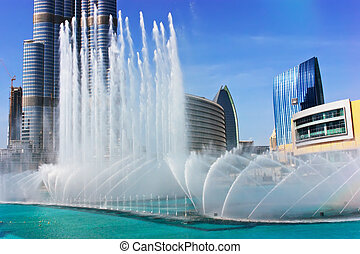The Dancing fountains downtown and in a man-made lake in Dubai