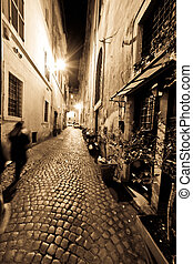 A dark and narrow alley in Rome, Italy
