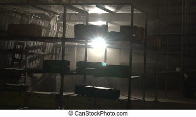 The dark warehouse with shelves