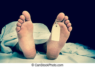 The dead man's body with blank tag on feet under white cloth...