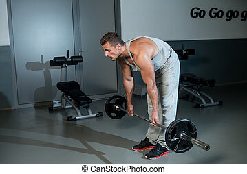 The Deadlift - Man Performing Heavy Deadlift In A Gym